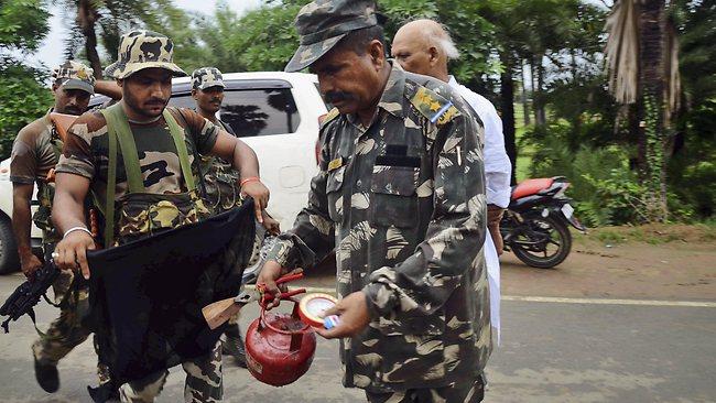 A bomb squad member defuses a suspected explosive device. Picture: Manish Bhandari/AP