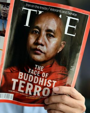 A man is seen reading a copy of the July 1 issue of Time magazine, carrying a picture of controversial Myanmar monk Wirathu on its cover, in Bangkok, on June 24, 2013. Sri Lanka has banned the issue over its cover story on Myanmar's Buddhist-Muslim clashes, which it said could hurt religious sentiment on the island, an official said on Tuesday. (AFP/File)
