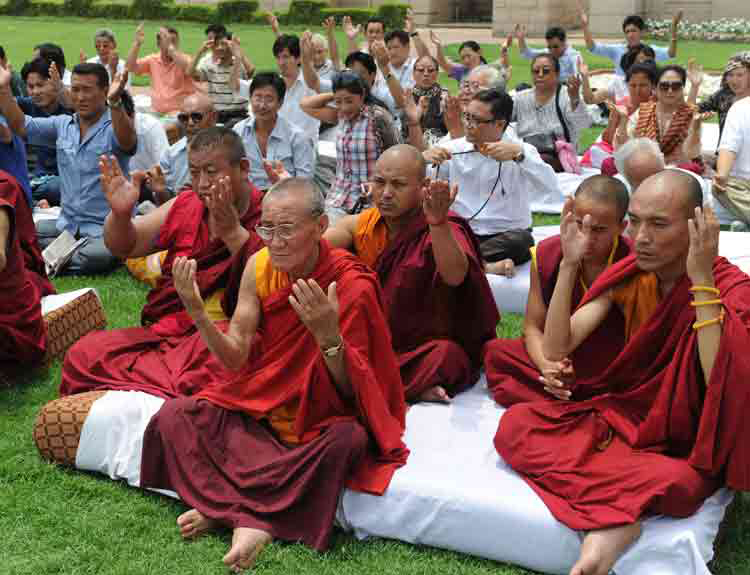 Buddhist Monks during an inter-faith prayer meeting following Sunday`s serial blasts at Bodhgaya temple.