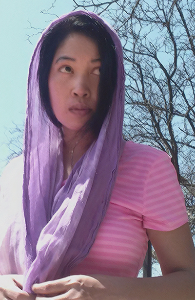 Jendhamuni wearing purple scarf